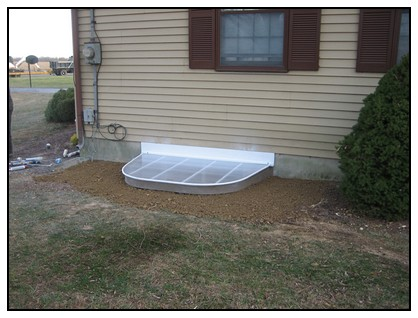 This is an exterior view of the egress window with a cover