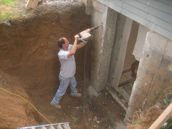 Man drilling hole on wall