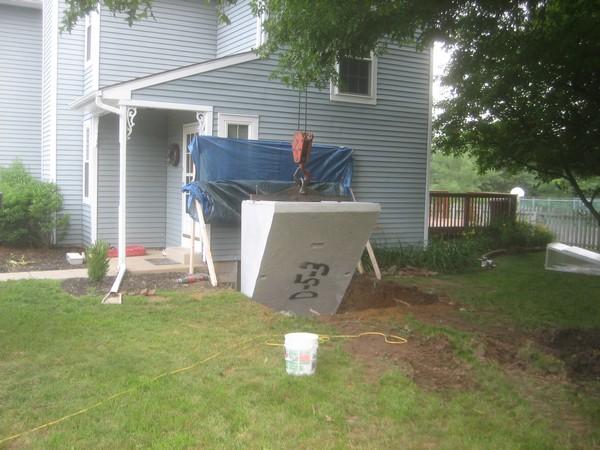 Crane working on Installation of Cleargress Door Basement Entrance