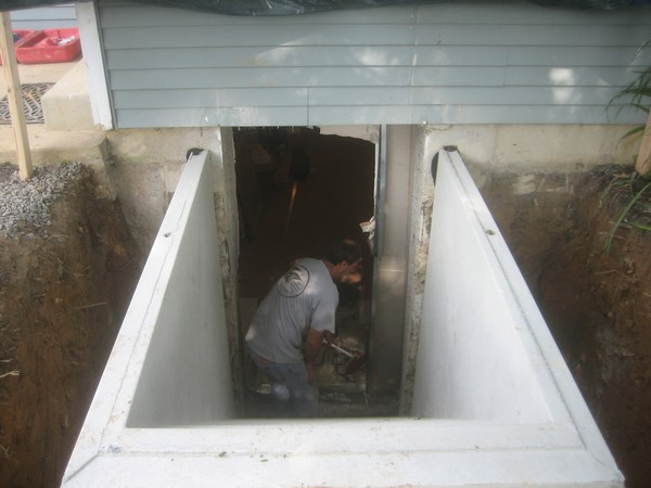Man working on Installation of Cleargress Door Basement Entrance