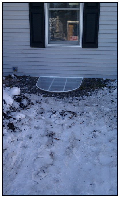 This is an exterior view of a finished egress window