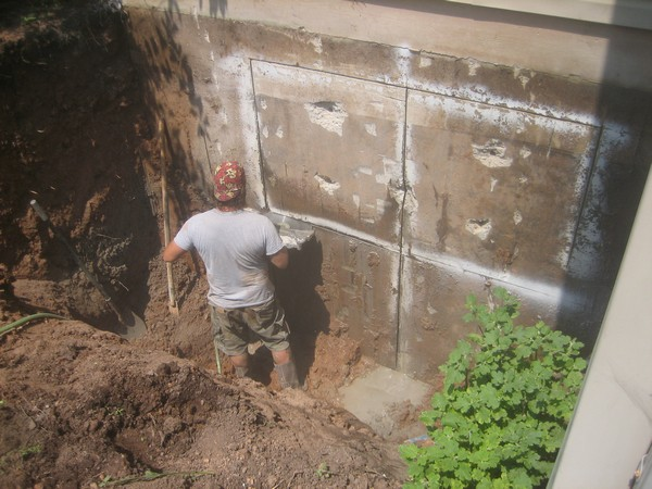 Man working on Custom basement entrance