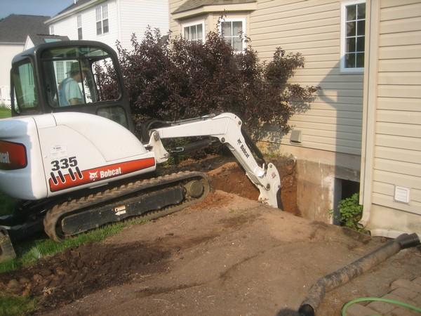 Crane digging basement