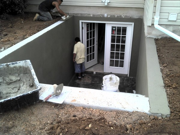 Working men installing Custom basement entrance