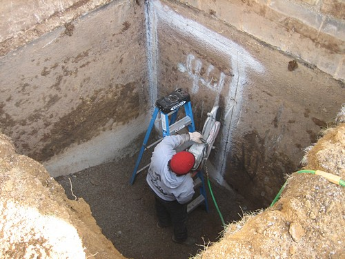 Man making opening for egress system