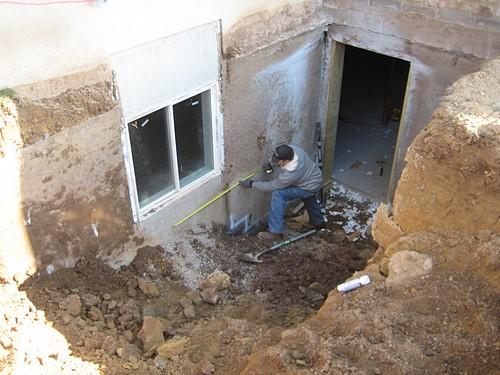 Man working on egress basement set up