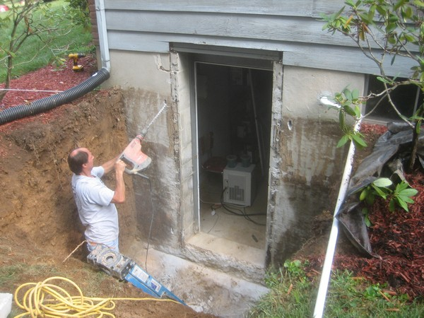 Egress Systems, Inc. workers drill holes for the PermEntry
