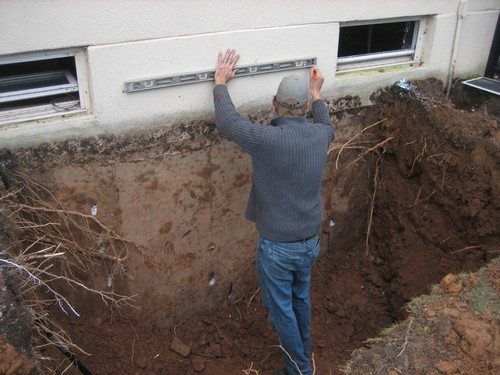 Man measuring width for egress installation