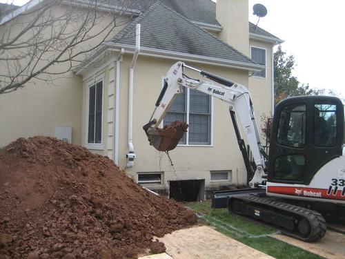 Crane digging basement ground