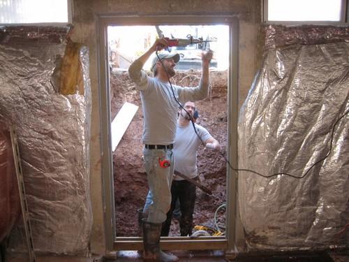 Working men building egress