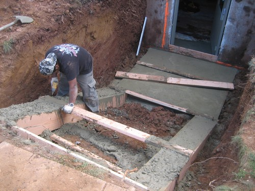 Man working on PermEntry stair system