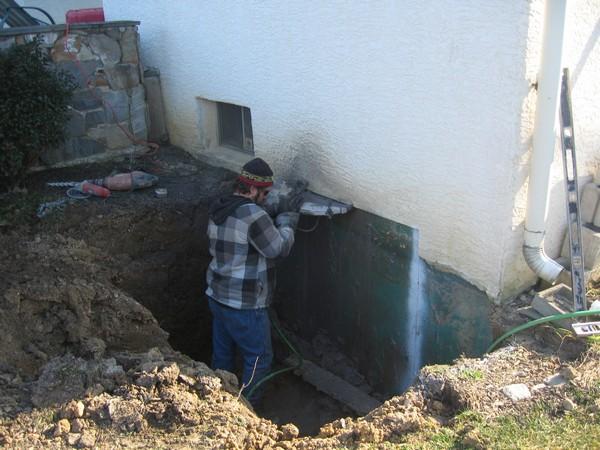 Man making entrance for basement entrance