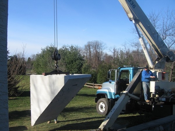 Crane holding PermEntry for installation