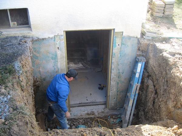 Man working on basement entrance