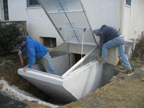 Two men setting up cleargress door