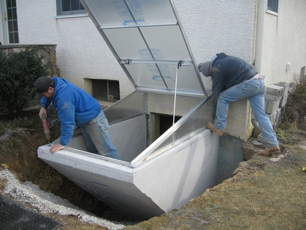 Men working on Installation of Cleargress Door Basement Entrance
