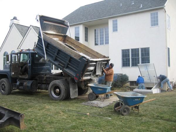 Men working on Egress Basement installtion