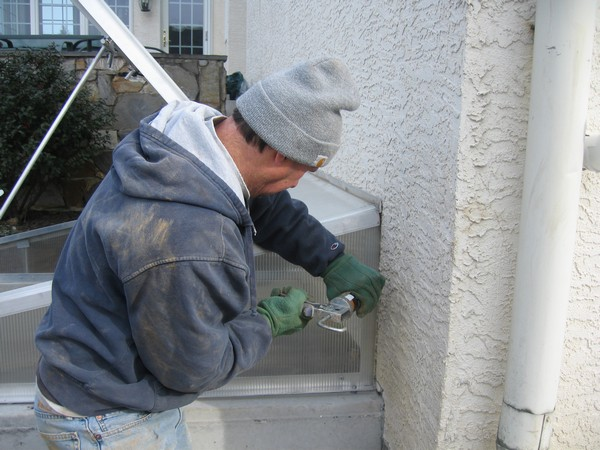 Man working on installation of Egress Systems PermEntry with Cleargress Door