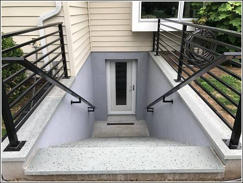 This is a custom basement entrance with added rails and single door
