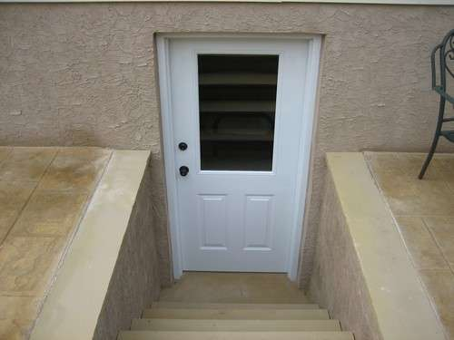 This is a custom single door basement entrance