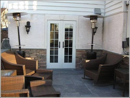A custom basement entrance with a patio