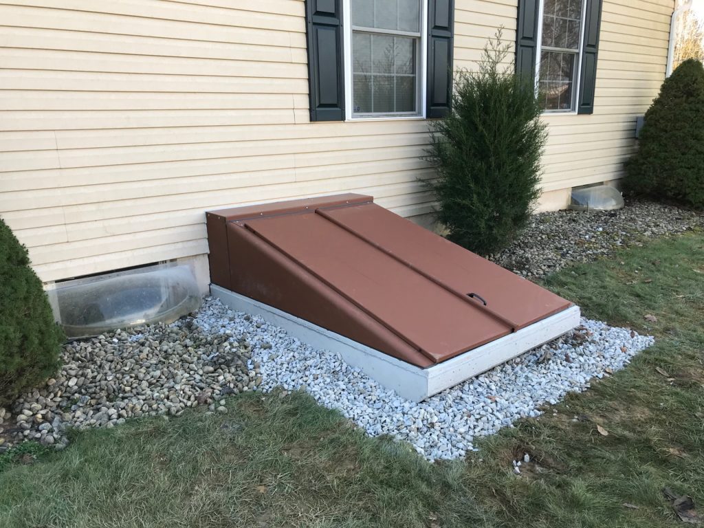Side of customer's home with the basement entrance