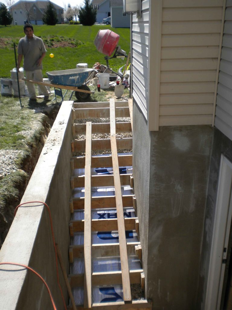 ESI worker next to custom entrance stairs