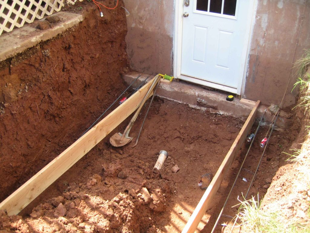 The excavated foundation for installing escape stairs