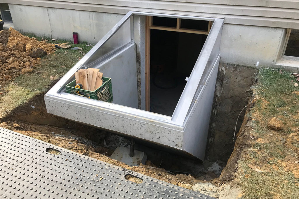 In process to install a Permentry precast concrete stair, with a Cleargress door, and a 3/0 x 6/8 insulated, 15 lite door at the base of the stair in TELEGRAPH ROAD, COATESVILLE