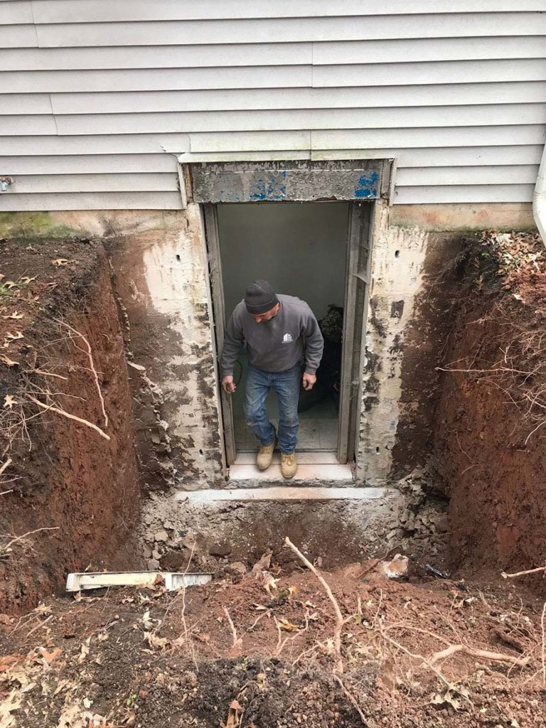 In process to remove those dangerous, worn out metal stairs and install new Permentry Precast Concrete stairs with a Bilco Door in BETHEL CHURCH ROAD – PARKERSFORD