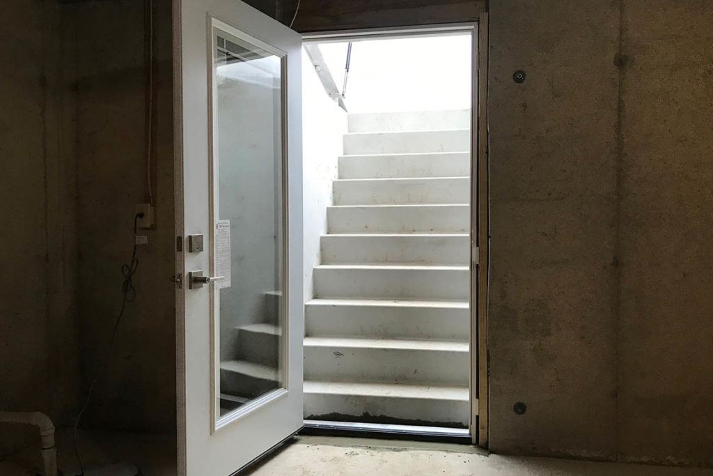 After installation of a Permentry precast concrete stair with a Cleargress door on top and a full light door at the bottom of the stairs in MEYER WAY, JAMISON