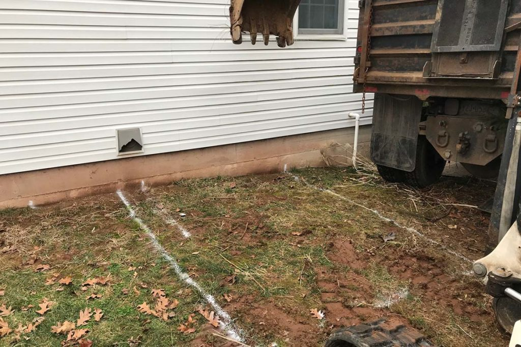 """In process to install Size """"E"""" Permentry Precast Stair with a Metal Bilco door on the rear wall of the house in HAMMERSMYTH COURT, HARLEYSVILLE"""