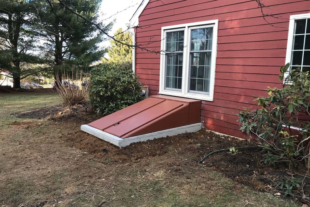 "After installation of Size ""E"" Permentry Precast Stair with a Metal Bilco door and a six panel insulated door at the base of the stairs in MOORE ROAD, DOWNINGTOWN"