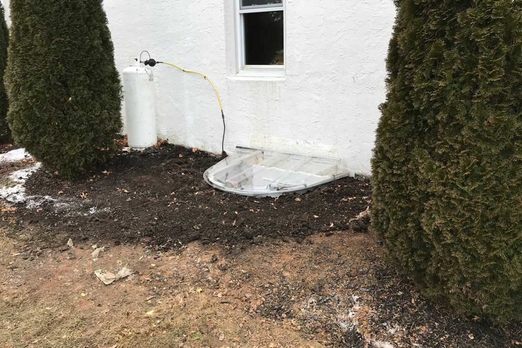 After installation of a Wellcraft model 5600 egress well, with a Wellcraft polycarbonate cover and a JeldWen, egress compliant casement window in VALLEY DRIVE, CHURCHVILLE